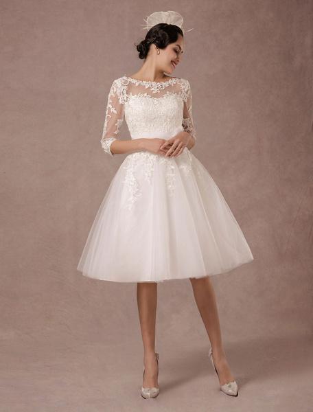 Élégante robe mariage bateau illusion